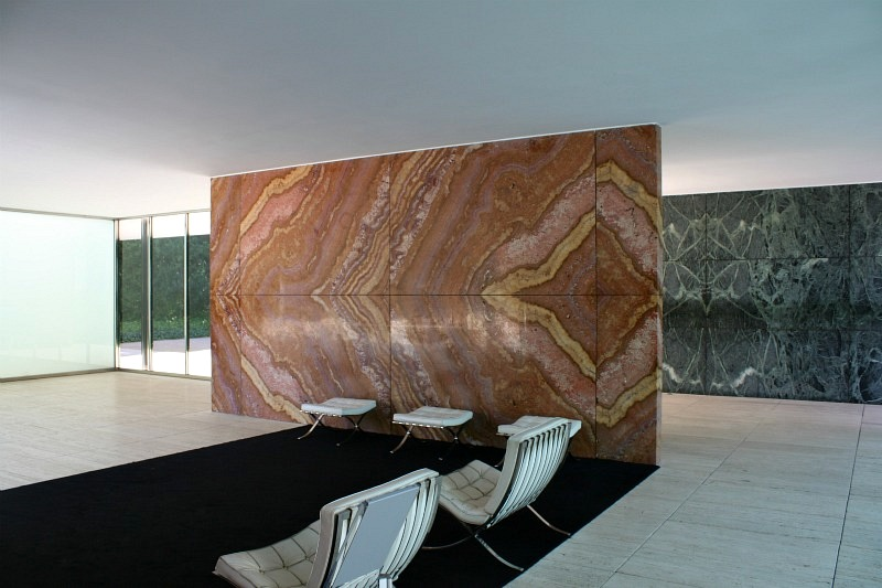 Marble, glass, and travertine planes intersect to form interior of the 1929 Pavilion in Barcelona